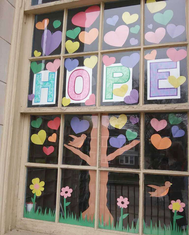 The Big Rapids Post Office is spreading hope and positivity through colorful messages and artwork displayed in its front window. To see it in person, visit the post office at 301 Maple St. Photo: Emalie Schuberg/Pioneer Photo