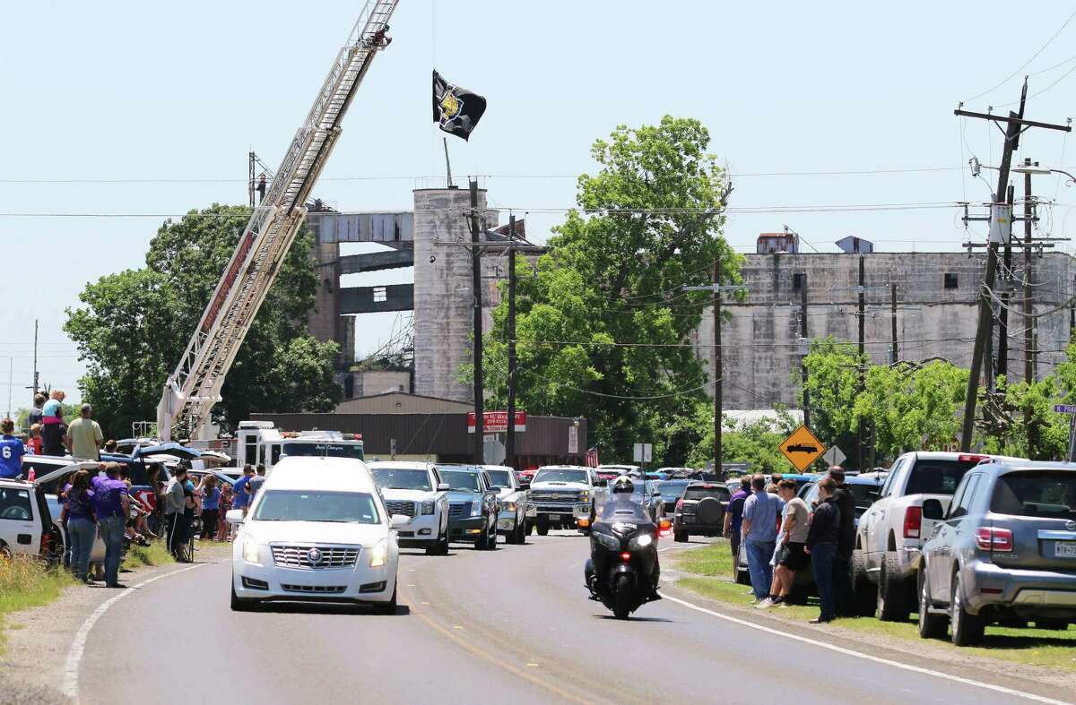 Hundreds of friends, coaches, and players that had been touched by the life of Coach Woods lined E. Clayton Street to show their love and support for the family.