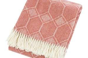 Tweedmill's Churchpane wool throw in cranberry, $70 at www.amara.com