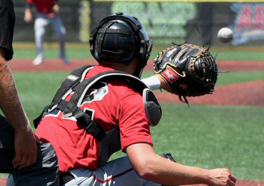 Edwardsville senior Nic Hemken receives a pitch at catcher during a game with his club team. Photo: Submitted Photo