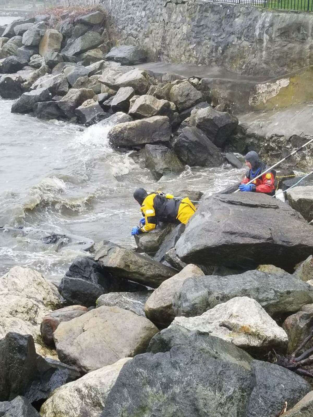 Stamford firefighters respond to the scene of a capsized two-person kayak on Wallacks Point early Sunday afternoon in Stamford.