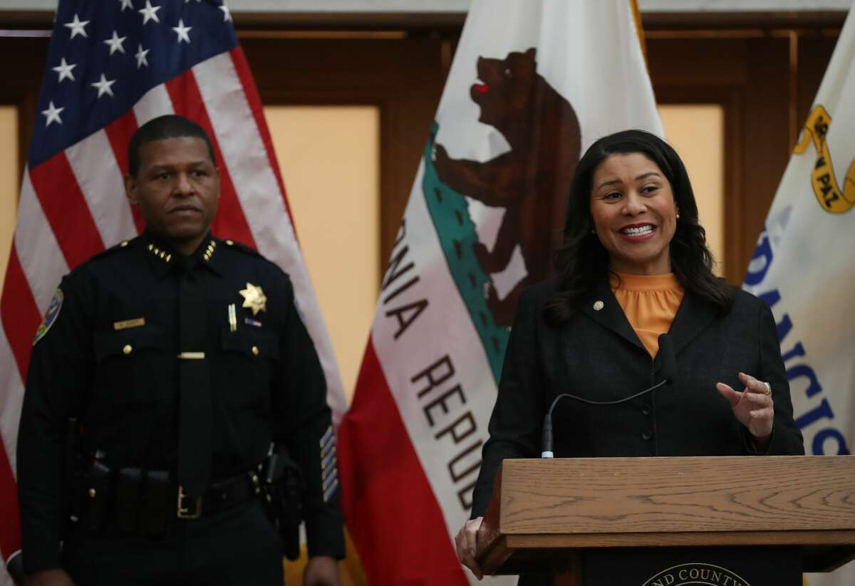 FILE: San Francisco Mayor London Breed (R) speaks during a press conference as San Francisco police chief William Scott (L) looks on at San Francisco City Hall on March 16, 2020.