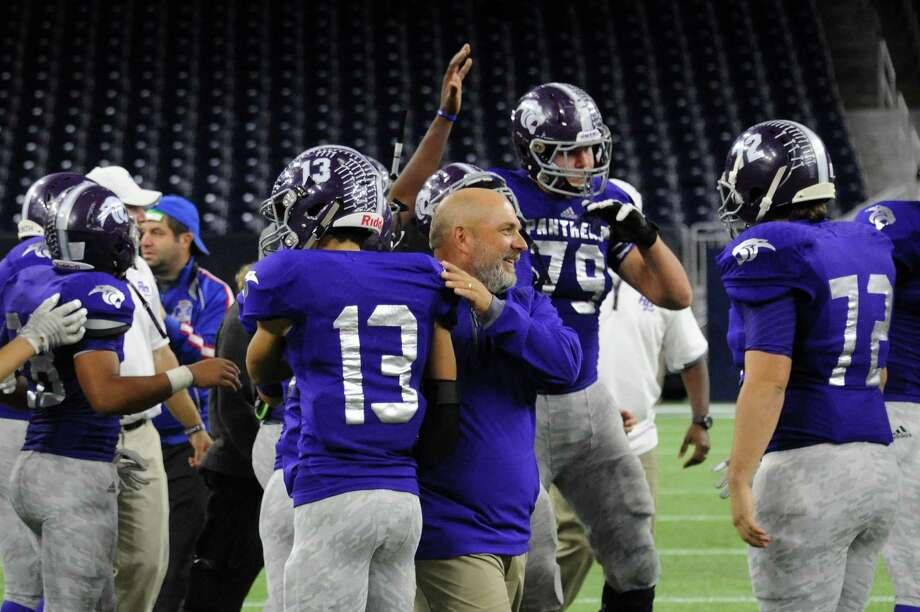 Ridge Point celebrates its regional semifinal victory against A&M Consolidated, Nov. 28 at NRG Stadium in Houston. Senior offensive tackle Travis Bruffy (79) was voted first-team all-state by the Texas Sports Writers Association following the season. Photo: Craig Moseley / Internal