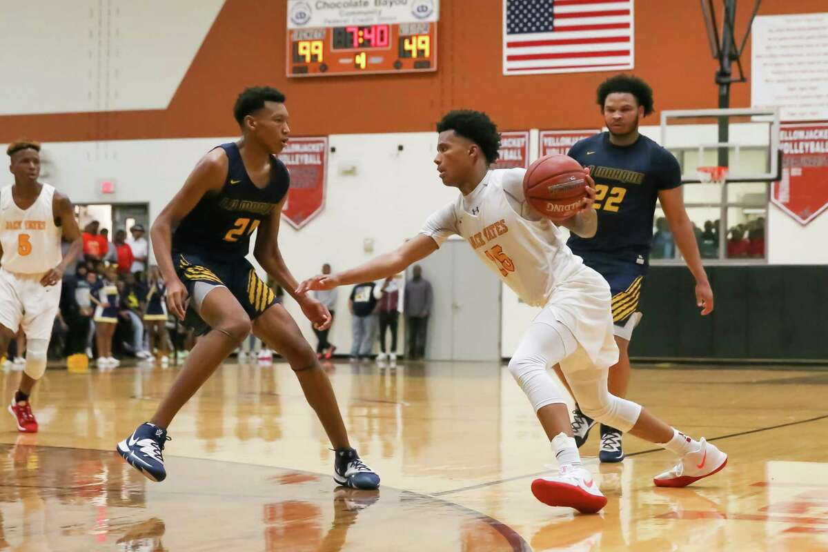 Yates Rubin Jones (15) drives the ball past La Marque Kevin Boone (21) in the third quarter the La Marque vs Yates boys' basketball Regional Quarter Final game on at Alvin High School Field House on March 2, 2020 in Alvin, TX.