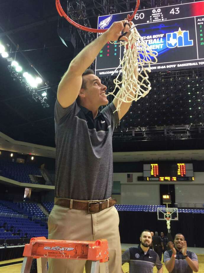 Tompkins Head Coach Bobby Sanders cuts down the net after the Falcons beat the Alief Taylor Lions 60-43 in the 6A Region III final at the Berry Center on March 3, 2018 Photo: Craig Moseley / Houston Chronicle / Houston Chronicle