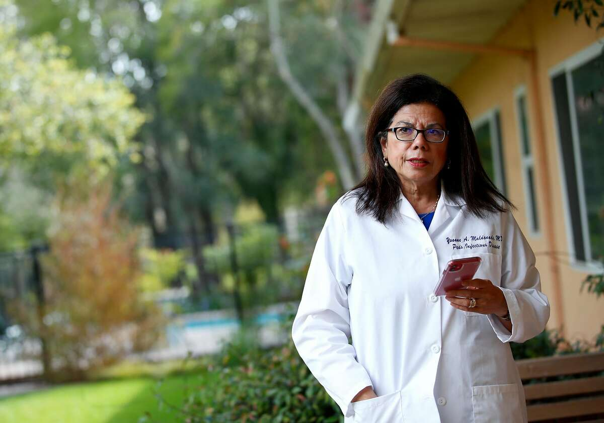 Stanford scientist Yvonne Maldonado is photographed during a phone conference call at her home office on Stanford campus, in California on March 27, 2020. Maldonado is one of the 10 scientists who is working on the coronavirus.