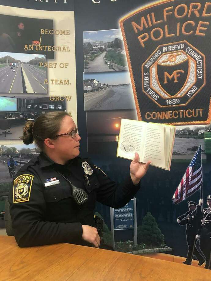 Officer Karen Banks reads to school children as part of the Books & Badges program. Photo: Milford Police Department / Contributed Photo / New Haven Register