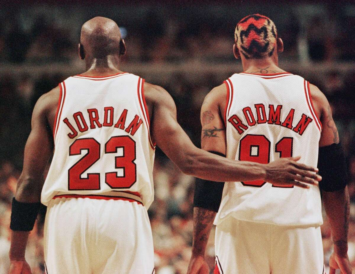 PHOTOS: A look at all of Dennis Rodman's hair designs from his time with the Spurs, Bulls and Lakers Michael Jordanpats Dennis Rodman after Rodman was called for a technical foul in a second-round playoff game against the Charlotte Hornets in 1998. Browse through the photos above for a look at Dennis Rodman's different hair color and designs ...