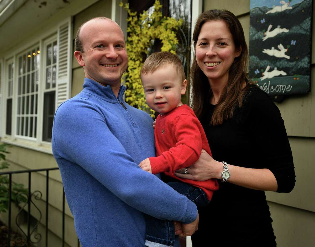 Zach and Katie Horan with their son Hunter, 19 months, at their home in Redding on Thursday. Son Brady, 6 weeks, is in the neonatal ICU at Connecticut Children's Medical Center in Hartford.