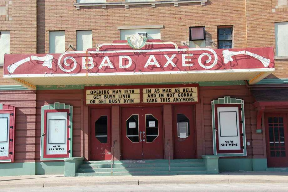 """The Bad Axe movie theater marquee is banking on Gov. Gretchen Whitmer's stay-at-home order coming to a close May 15, as it is promoting the theater will be opening May 15.It quotes the classic movies """"Network"""" and """"The Shawshank Redemption"""" in doing so. (Robert Creenan/Huron Daily Tribune)"""