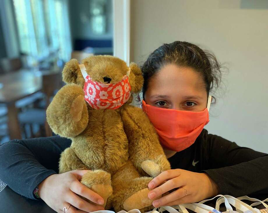 Scarlett Kniffen, 14, has made masks for refugees. Photo: Contributed Photo / Connecticut Post