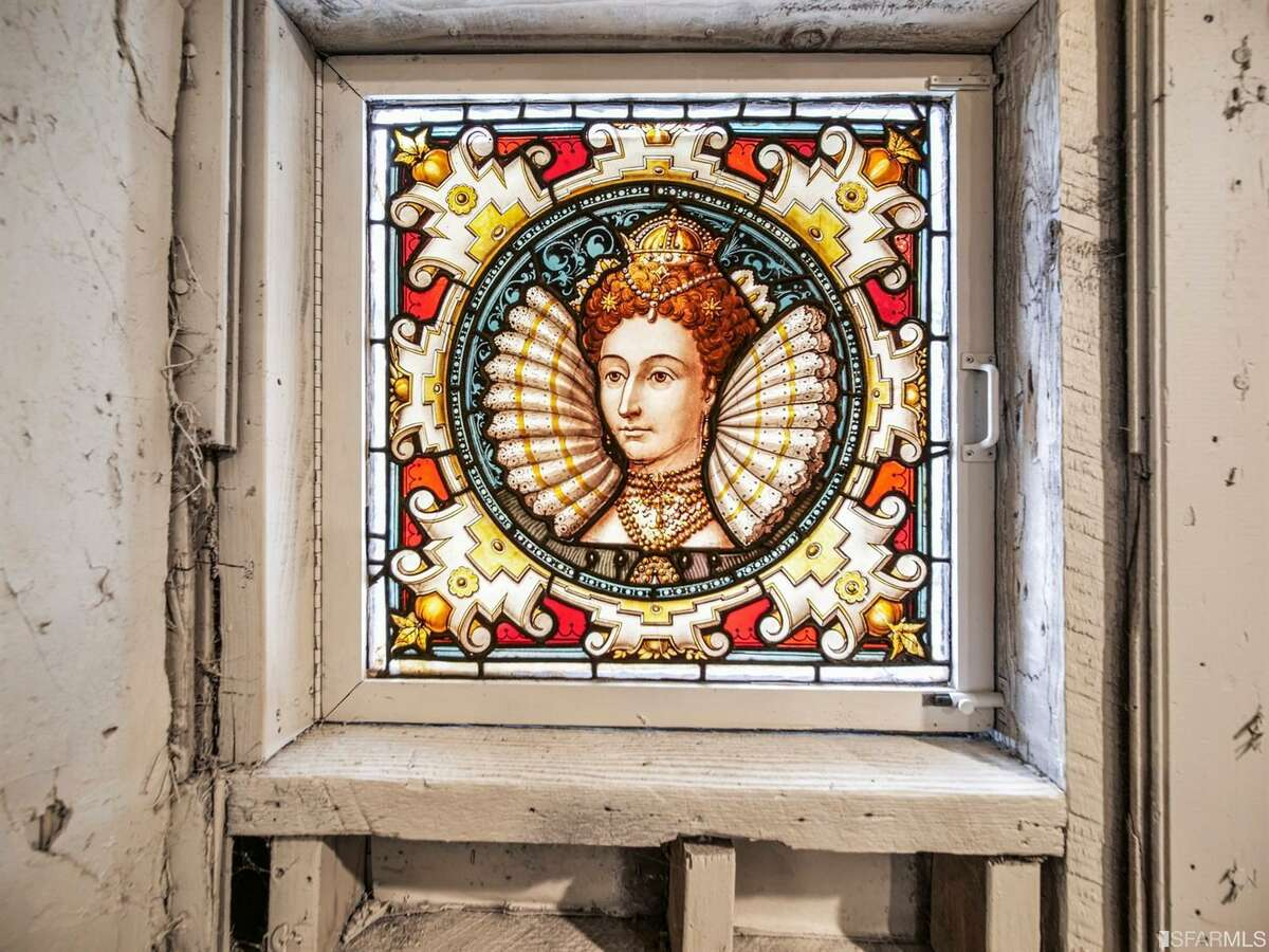 Listing agent Dirk Kinley of Compass tells us the previous owner restored historical artifacts. The house has several stained glass windows like this unique portrait of Queen Elizabeth I.