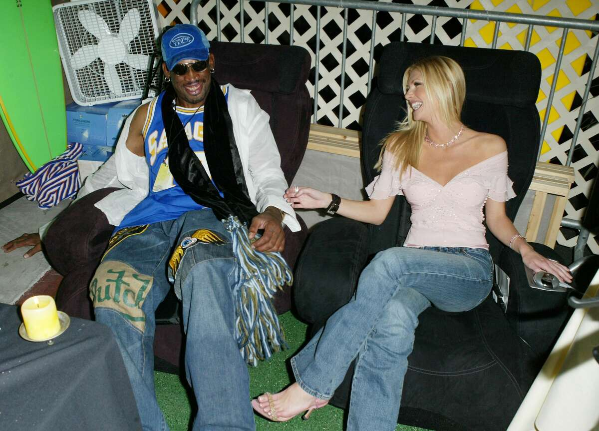 LAS VEGAS - OCTOBER 27: Former NBA player Dennis Rodman and actress Brande Roderick sit on the Sharper Image massage chairs at the 2003 Tall Pony Radio Music Awards gift lounge, outside the Aladdin Hotel and Casino, October 27, 2003 in Las Vegas, Nevada. (Photo by Frazer Harrison/Getty Images)