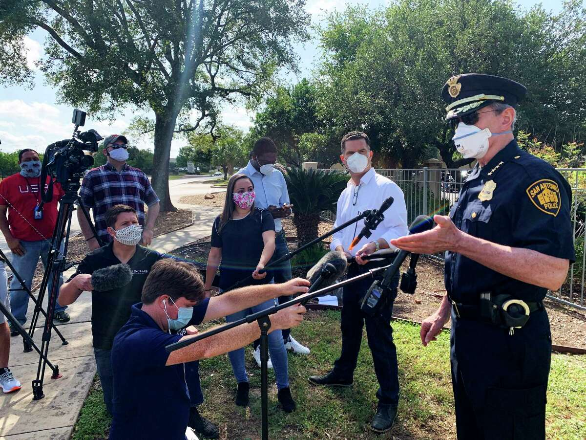 San Antonio Police Chief William McManus addresses media personnel, clad in facemasks to protect against the coronavirus pandemic, at the Sedona Ranch apartments, 17655 Henderson Pass, where a woman who lost custody of her two children allegedly killed the children and her mother before killing herself on Monday, April 27, 2020.
