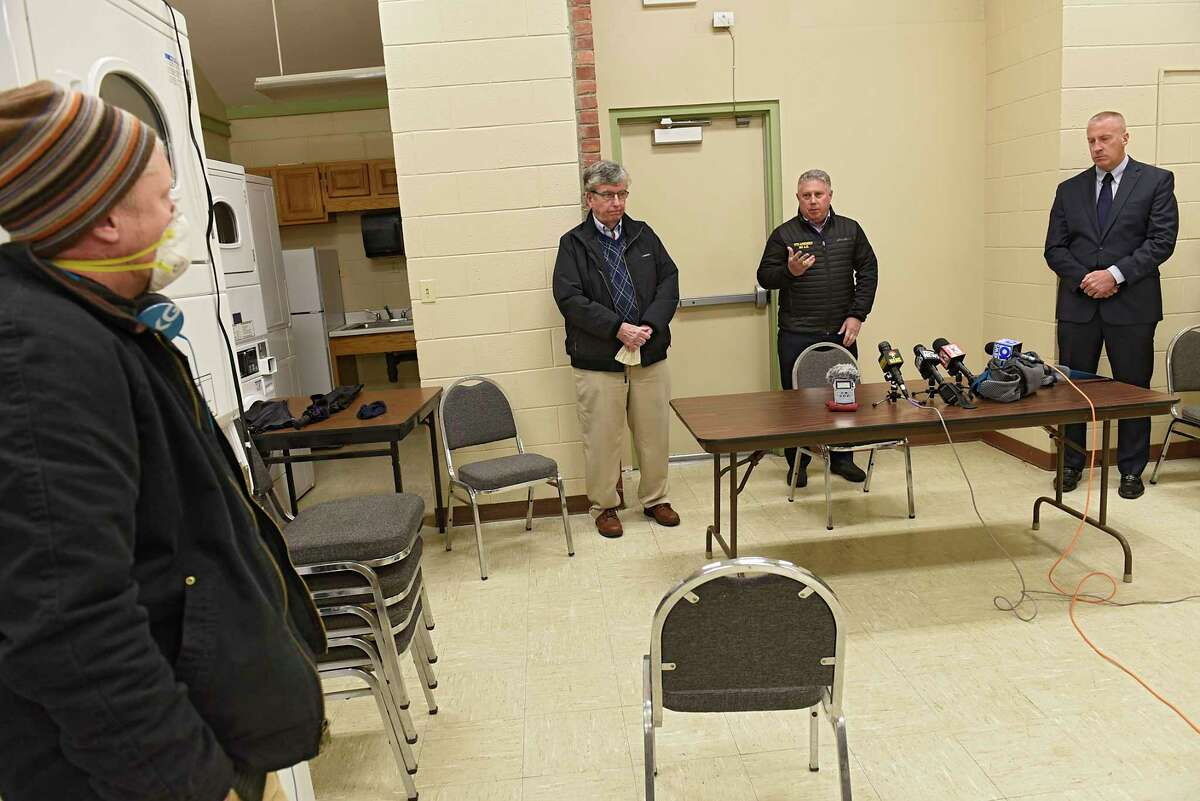 A reporter, at left, asks a question at Senator Neil Breslin, second from left, Assemblymember John McDonald, second from right, and Mayor William Keeler, right, during a press conference at the Saratoga Sites community room regarding the results of the Bennington College study on PFAS levels around the Norlite incinerator on Monday, April 27, 2020 in Cohoes, N.Y. (Lori Van Buren/Times Union)