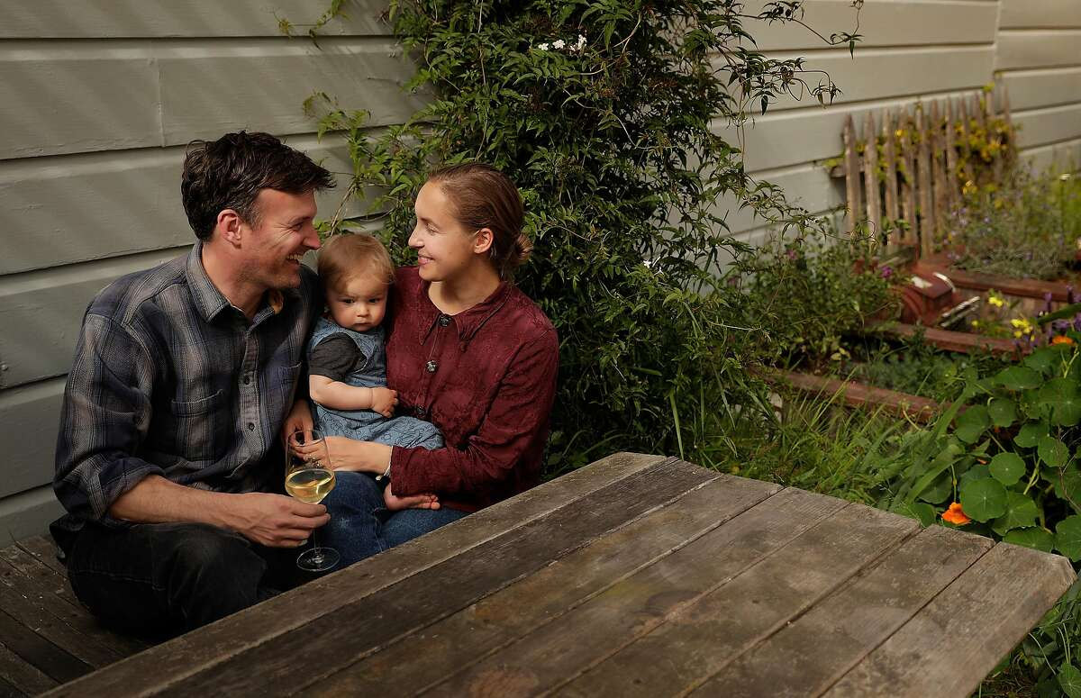 Charlie Miller and Emma Rosenbush with their son Frank, 13 mos, and dog Dewey in the yard of their home in San Francisco, Calif., on Wednesday, April 22, 2020. Charlie and Emma created Dewey's Wines named after Dewey, and produce four wines.