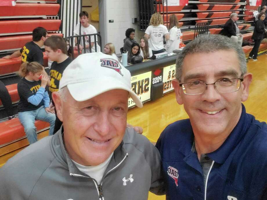 John Niski at right stands with CIAC Assistant Director of Unified Sports Paul Mengold at a Unified Sports basketball game. Photo: Shelton High Athletics / Contributed Photo