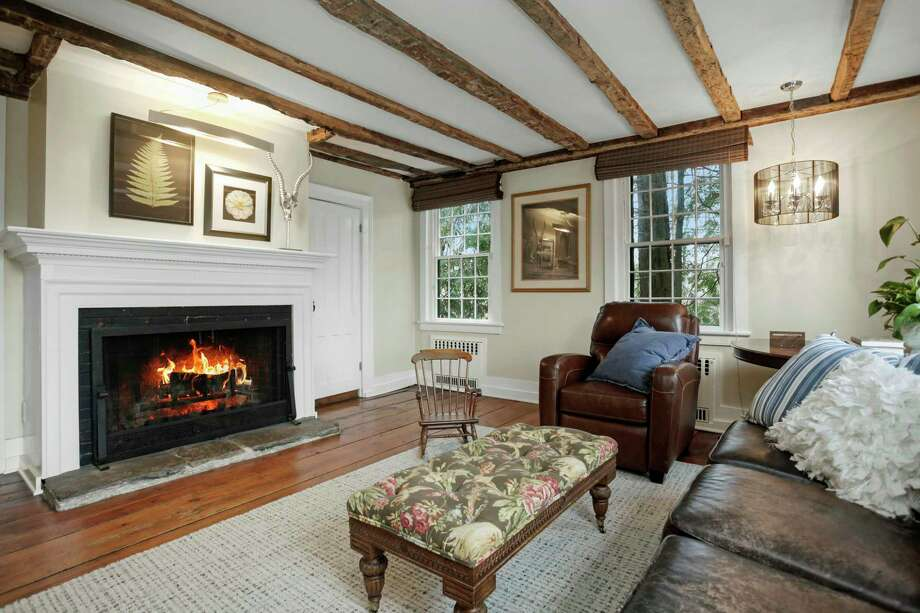 The family room features a fireplace and exposed beams.