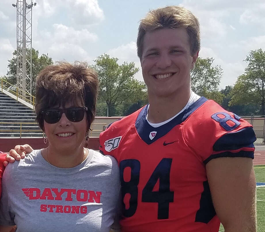 Adam Trautman poses with his mother Lori Trautman (née Stephenson), a member of Dow High's 1982 SVL championship girls' basketball team, during the University of Dayton's 2019 Media Day. Photo: Photo Provided