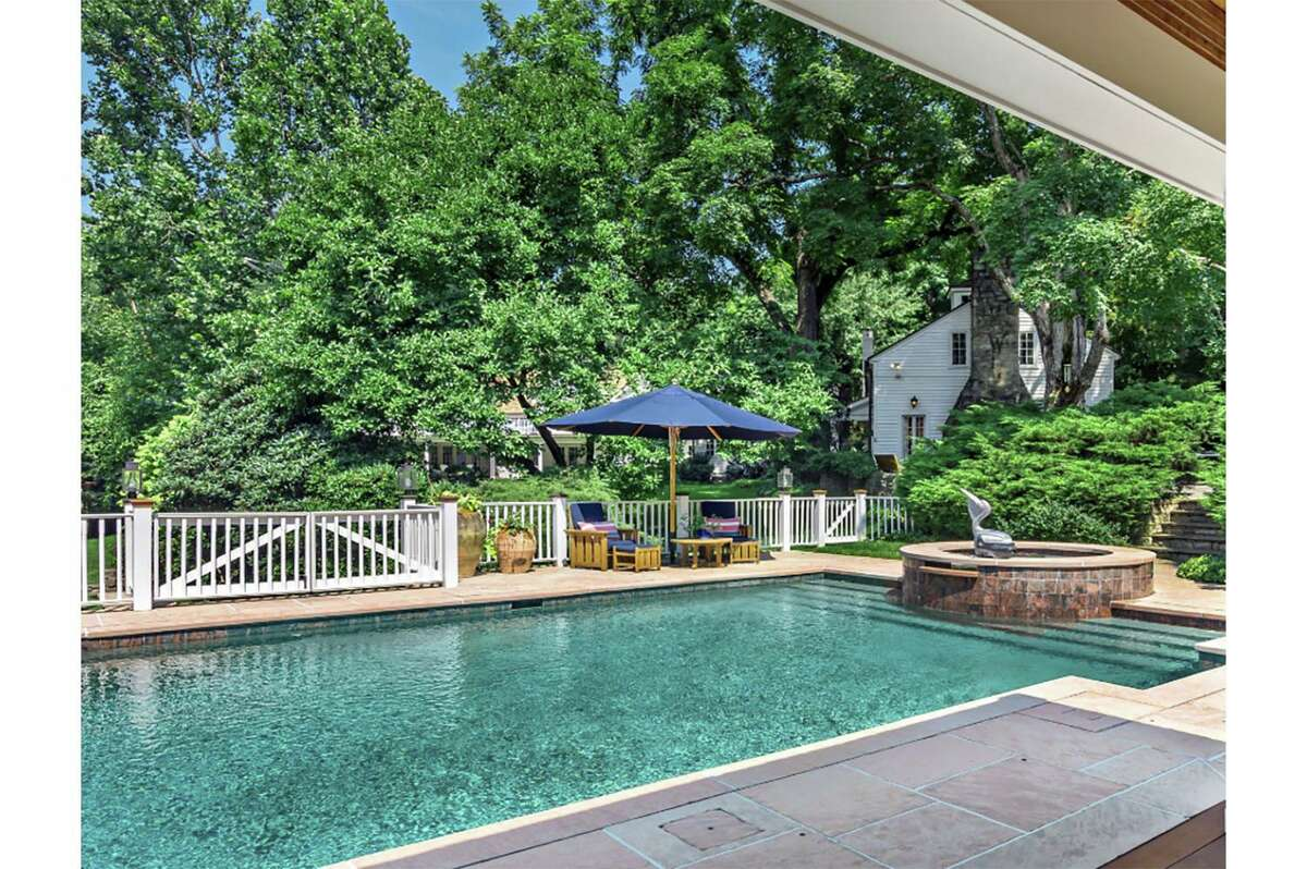This 12.7-acre, four parcel estate features an in-ground swimming pool and spa.