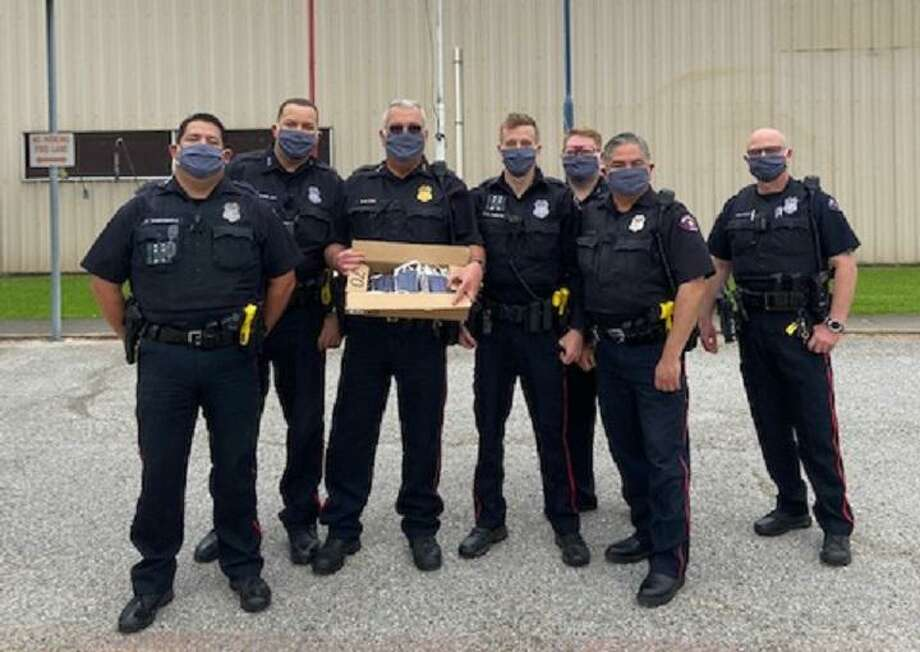 Among groups receiving donated handmade face masks from Pasadena Moose Lodge No. 1721's Annette Davis, Bobbie Barbara and Peggy Dow is the Pasadena Police Department. Photo: Courtesy