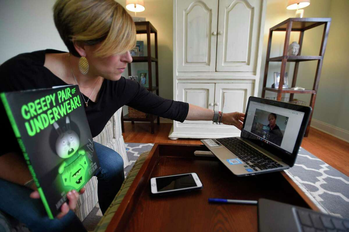 Stamford teacher Stacey Wood prepares to record herself reading a book to her students at her home in Fairfield April 3. Schools across the state closed March 13 in response to the COVID-19 pandemic and moved to online learning platforms.