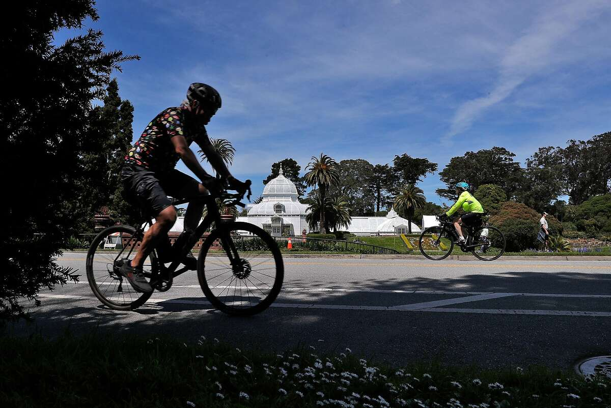 Bicyclists ride on John F. Kennedy Drive in Golden Gate Park in San Francisco, Calif., on Monday, April 27, 2020. City health officials extended the stay at home order until the end of May, and will be shutting down the street to vehicle traffic.