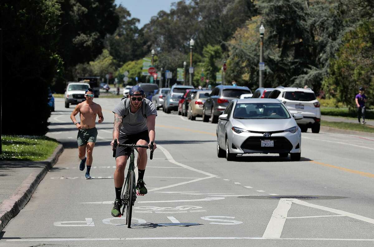 Traffic of several kinds on John F. Kennedy Drive in Golden Gate Park in San Francisco, Calif., on Monday, April 27, 2020. City health officials extended the stay at home order until the end of May, and will be shutting down the street to vehicle traffic.