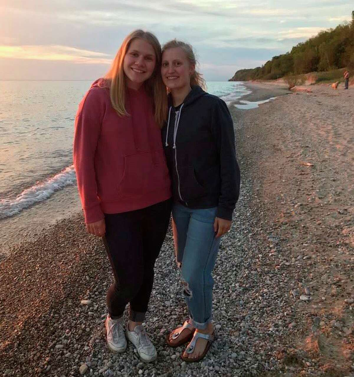 Solveig Saeternes from Trondheim, Norway and Laura Krause from Germany enjoy a sunset on Lake Michigan during their stay in Bear Lake. Both of the former foreign exchange students shared what conditions are like in their country with the COVID-19 pandemic. (Courtesy photo)