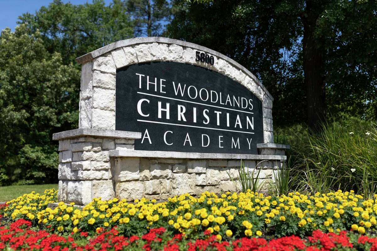 Signage is seen at the entrance of The Woodlands Christian Academy, Monday, April 27, 2020.
