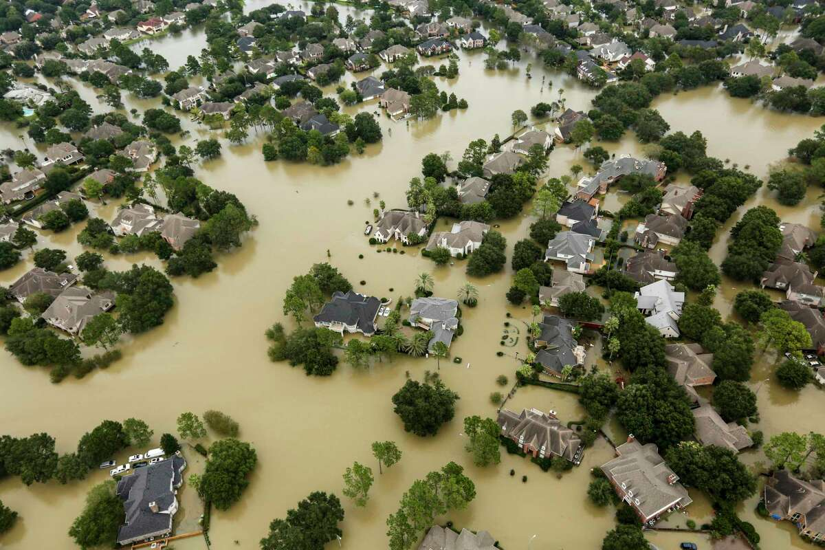 Floodwaters from the Addicks Reservoir inundate a neighborhood in the aftermather of Hurricane Harvey in 2017. Climate data model increased warming in Texas, and with it, warmer and more severe weather. Is Texas prepared?