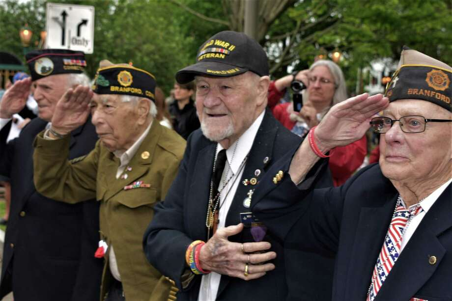 Branford has cancelled its 2020 annual Memorial Day parade and ceremonies, Branford Veterans Parade Committee Bill O'Brien said Monday, April 27, 2020. This is a scene from the 2018 parade. The town's annual Memorial Day observance, including the popular Memorial Day Parade, date back to the end of World War I. Photo: Bill O'Brien / Contributed