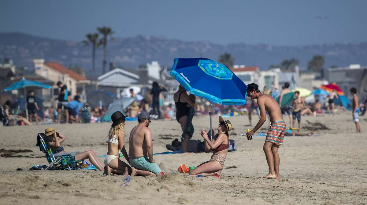 Thousands of beach-goers enjoy a warm, sunny day at the beach amid state-mandated stay-at-home and social distancing mandate to stave off the coronavirus pandemic in Newport Beach, CA, on April 25, 2020.