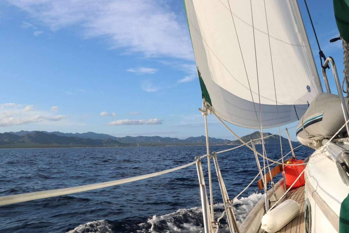 The couple has been on the boat since October of 2019. During the first month, they sailed down the California coast, then spent the next four months traveling down the Mexico coast. In the winter they began hearing murmurings about the coronavirus, but Mexico hadn't really acknowledged the situation until they were about to leave its coast. In March, while sailing past Guatemala, they heard El Salvador closed its border to foreigners. Then, Costa Rica closed its border. Suddenly, they had a narrow weather window to make it to Nicaragua, the only place that would let them on land, and hope they weren't turned away. They've been stuck aboard their 35-foot sailboat off the coast since March 13, due to the coronavirus pandemic - thankfully able get on shore to get supplies or some exercise.