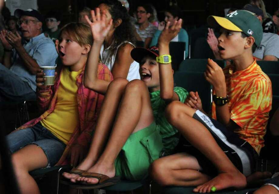 Fans, from left, Charlotte Meyer, 10, Pierce Barry, 10, and Quinn Barry, 11, from left react during televised coverage of Fairfield American in game one of the Little League World Series Friday August 20, 2010 at Pequot Library in Southport. Photo: Autumn Driscoll / Connecticut Post