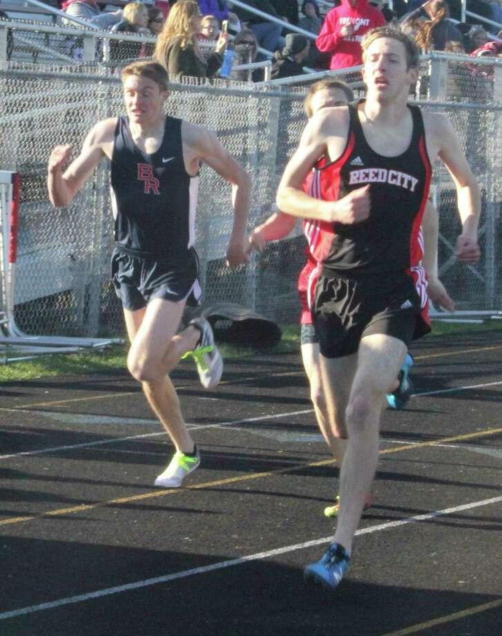 Calvin Rohde (right) heads to the finish line in a track meet last season. (Pioneer file photo)