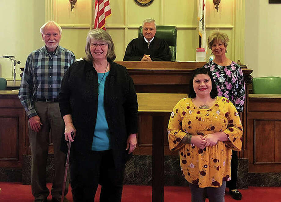 The newest Morgan County Court Appointed Special Advocates are Gary Morris (from left), Tonda Stouffe, Nikki McPherson and Susan Hall. They were sworn in by Judge Jeffery Tobin (center). Photo: Photo Provided