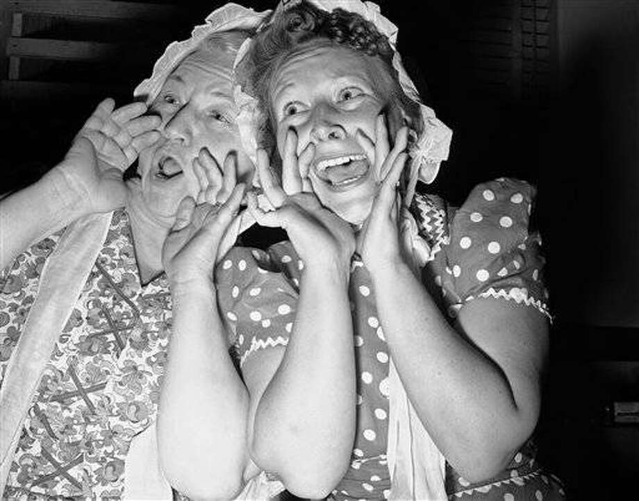 Techniques of hog and husband calling do not greatly vary if this picture, taken at annual meeting of Union Pacific Railroad Employs Organization is any criterion in Los Angeles, April 28, 1941. Mrs. D.J. Cahoon, right, who won husband calling competition, and Mrs. C.H. Sphar, who was judged best hog caller. Both are wives of Los Angeles railroad men. (AP Photo)