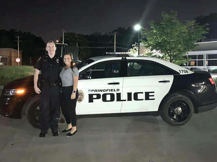 Springfield, Missouri, police officer Josiah Overton, seen with his fiancée, Abigail McEvers, was shot while on duty in March. Overton, a 2013 graduate of Routt Catholic High School, is recuperating and is expected to be back at work sometime in May. Photo: Provided PhotoProvided Photo
