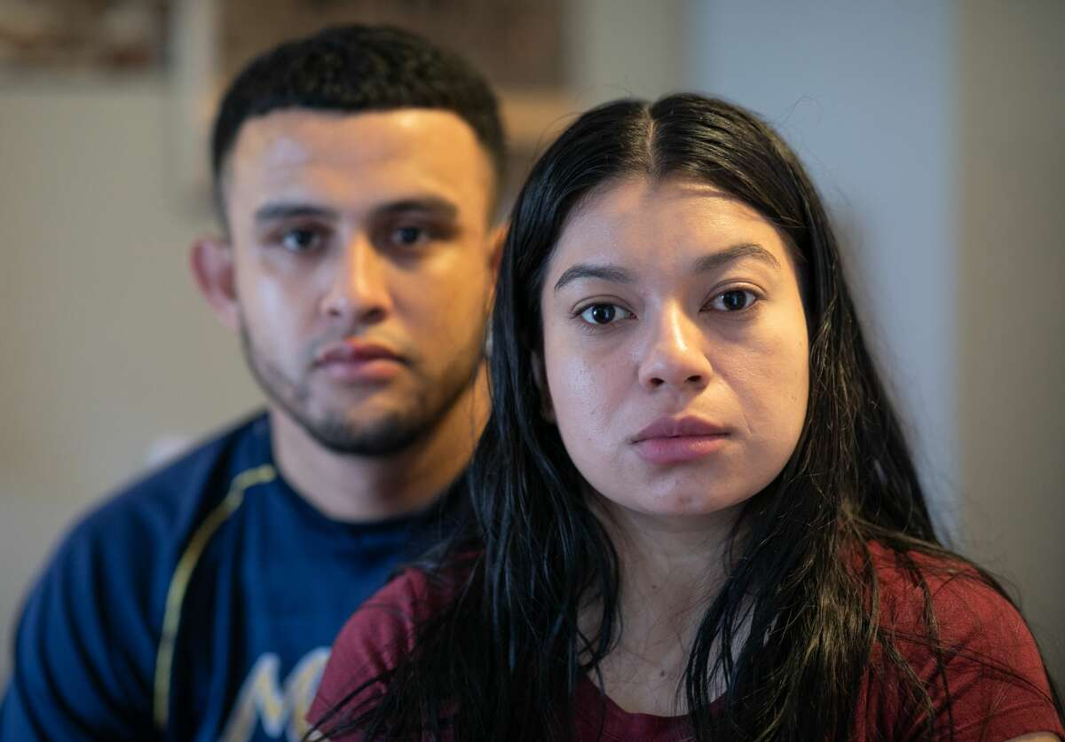 Undocumented immigrant Juana, 24, from El Salvador and her husband Saul, 23, from Honduras sit in their one-room apartment on March 25, 2020 in Norwalk, Connecticut. Juana lost her job as a house cleaner and Saul as a painter due to the coronavirus (COVID-19) pandemic. Undocumented immigrants cannot collect unemployment. Nor will they benefit from federal government bailout legislation.