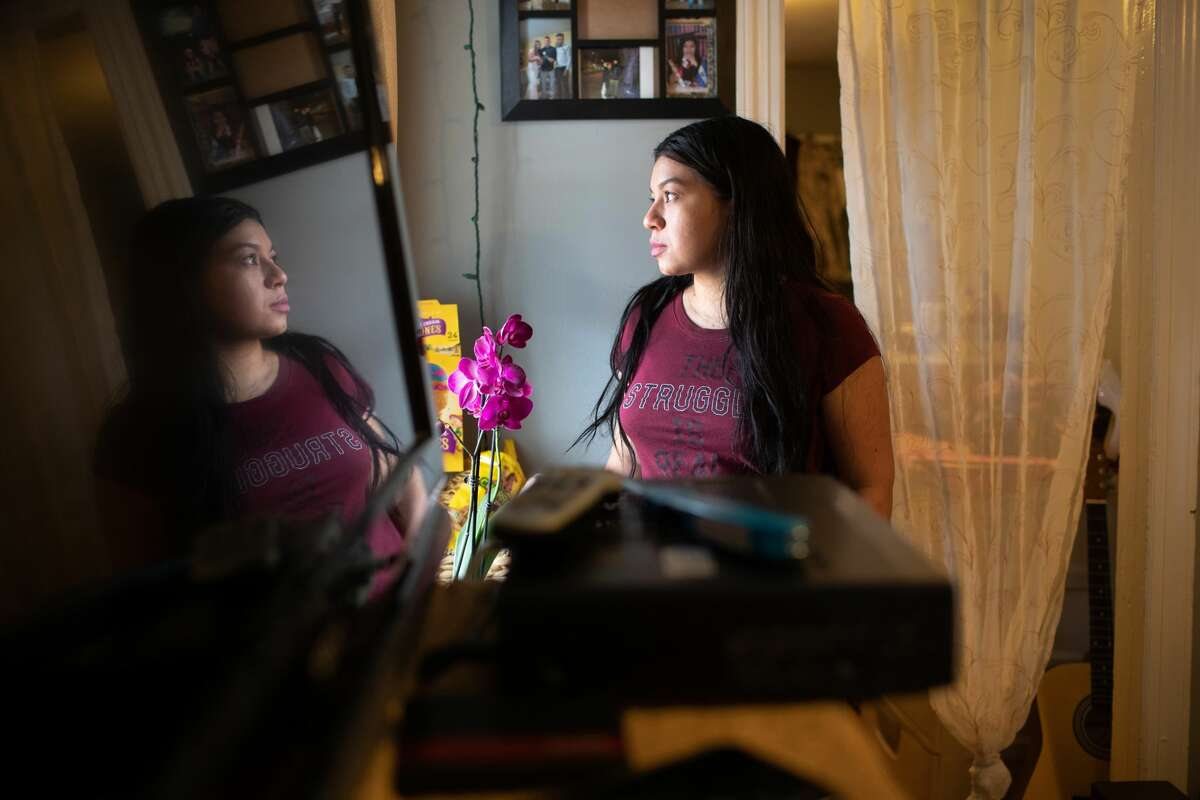 Undocumented immigrant Juana, 24, from El Salvador looks from her one-room apartment on March 25, 2020 in Norwalk, Connecticut. She lost her job as a house cleaner and her husband as a painter due to the coronavirus (COVID-19) pandemic. Undocumented immigrants cannot collect unemployment. Nor will they benefit from federal government bailout legislation.
