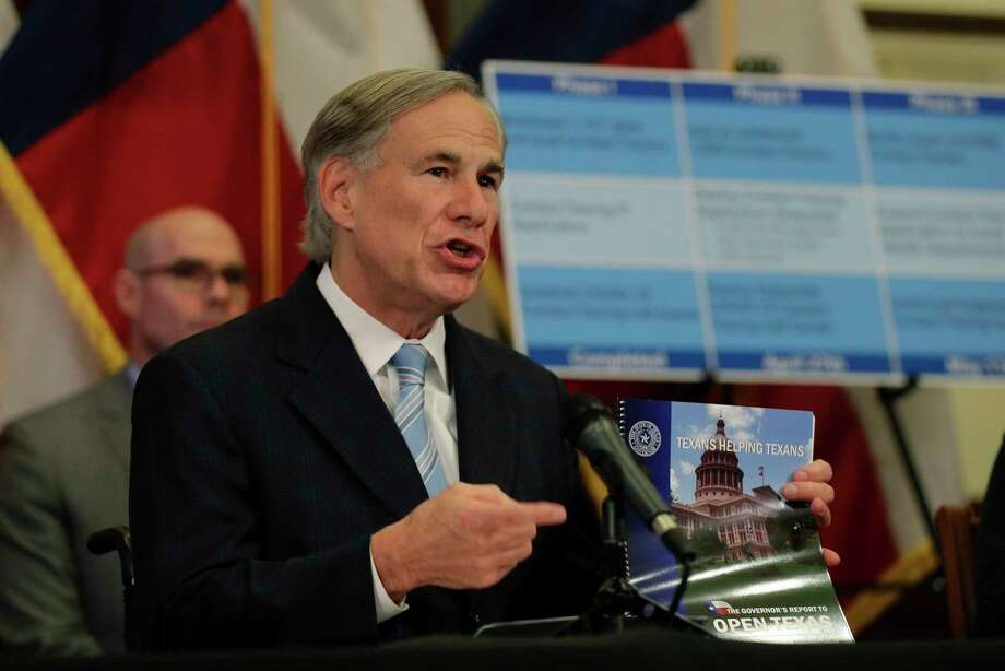 Texas Gov. Greg Abbott holds the Governor's Report to Reopen Texas during a news conference where he announced he would relax some restrictions imposed on some businesses due to the COVID-19 pandemic Monday, April 27, 2020, in Austin, Texas. (AP Photo/Eric Gay) Photo: Eric Gay, STF / Associated Press / Copyright 2020 The Associated Press. All rights reserved.