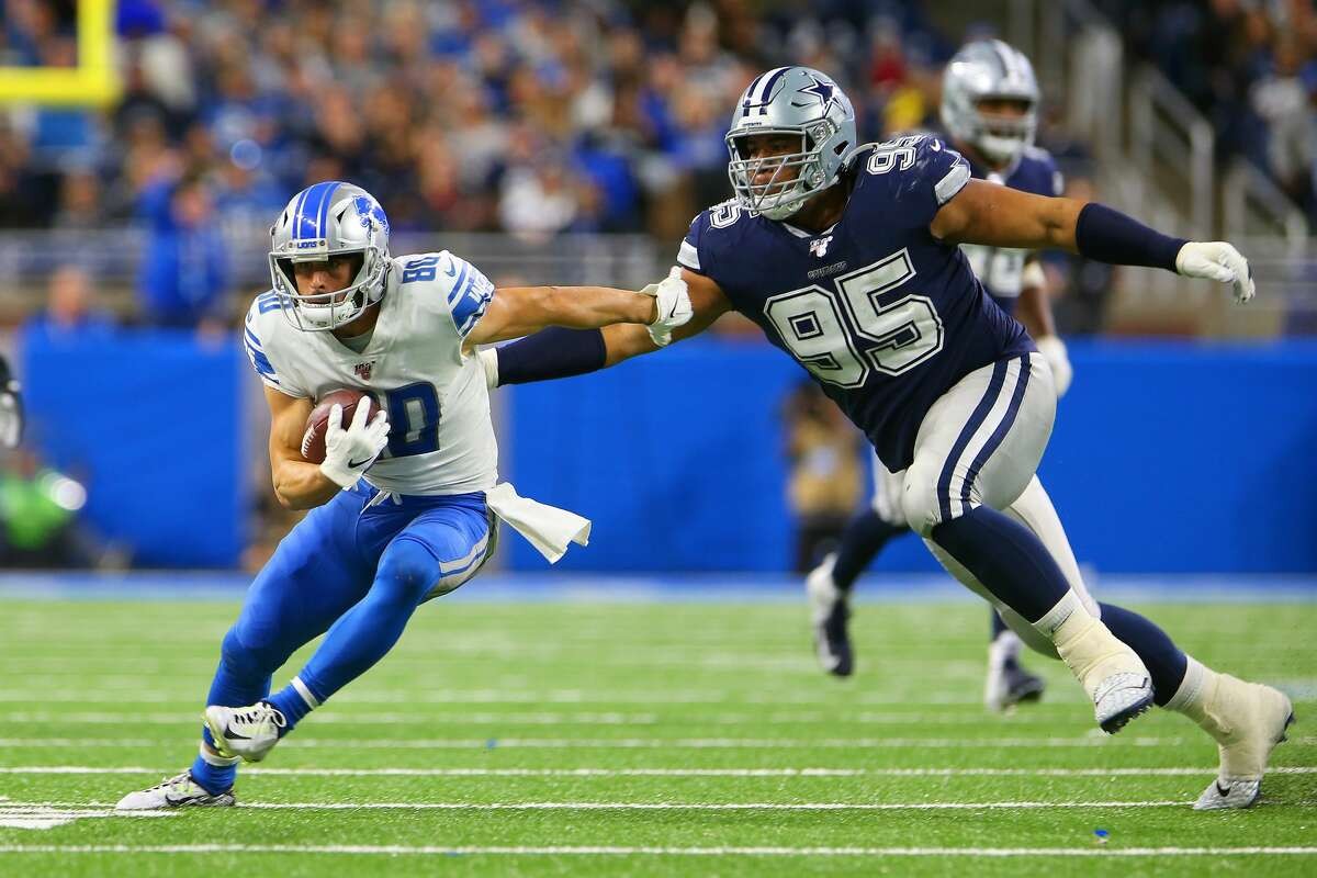 Detroit Lions wide receiver Danny Amendola (80) carries the ball under the pressure of Dallas Cowboys defensive end Christian Covington (95) during the second half of an NFL football game against the Dallas Cowboys in Detroit, Michigan USA, on Sunday, November 17, 2019. (Photo by Amy Lemus/NurPhoto via Getty Images)