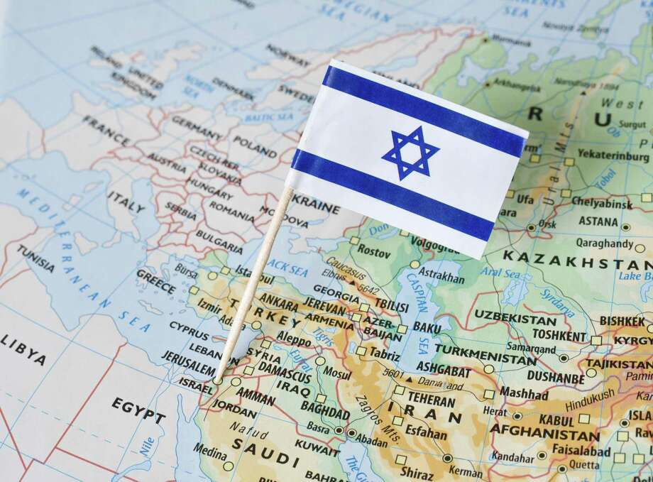 Israel paper flag pin on a map. Photo: Dreamstime / © Sjankauskas/Dreamstime / (c) Sjankauskas | Dreamstime.com