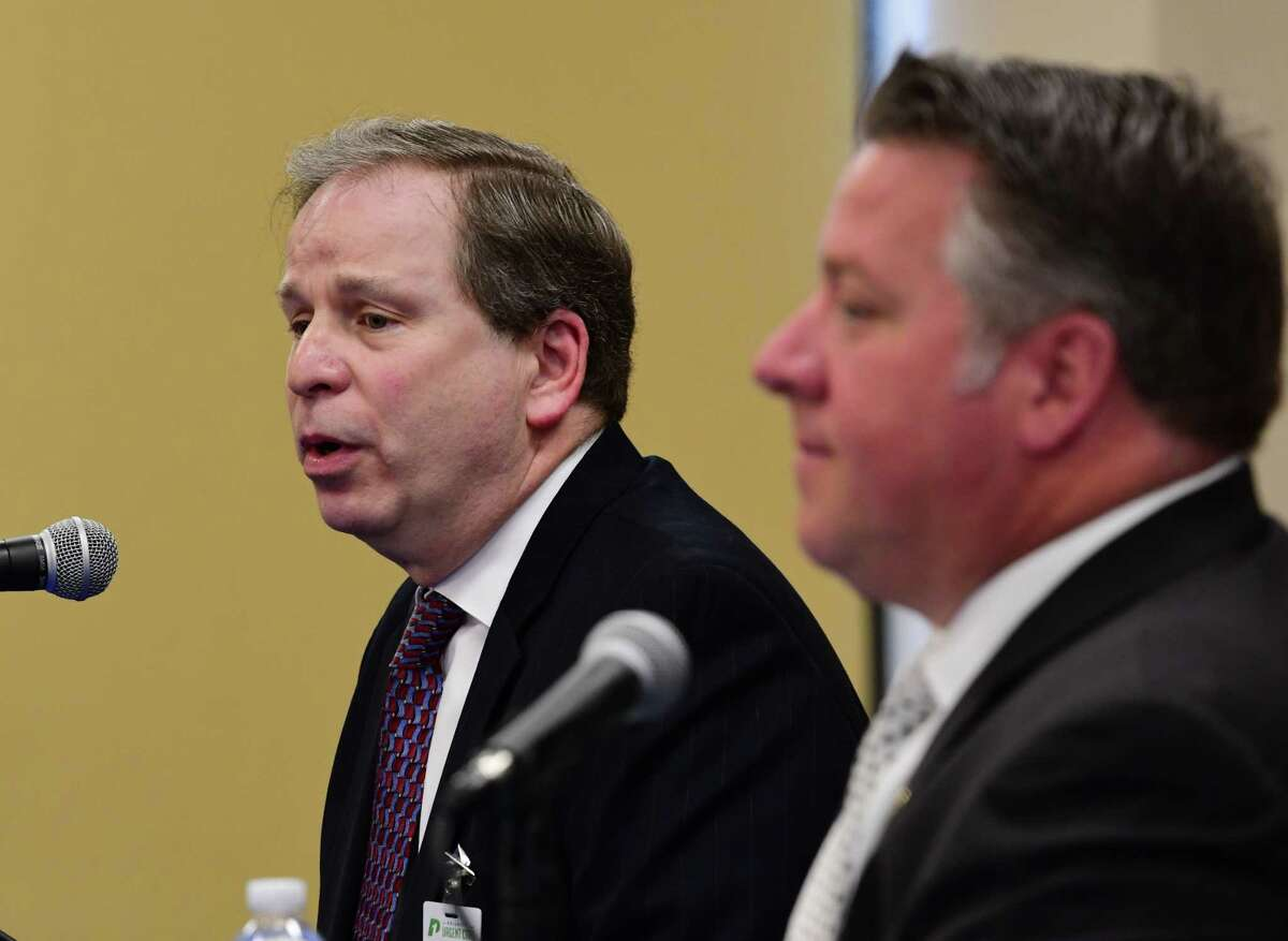 Dr. Jonathan Halpert, Priority 1 Urgent Care, left, speaks as Albany County Executive Daniel McCoy, right, holds his daily coronavirus briefing on Tuesday, April 28, 2020 in Albany, N.Y. (Lori Van Buren/Times Union)