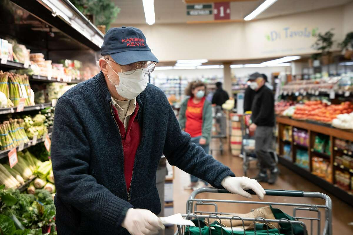 Rene Azigdor, 85, of San Jose, shops at Zanotto's Willow Glen Market Thursday, March 19, 2020, in San Jose, Calif. The store is open only to seniors from 8 - 9 a.m.