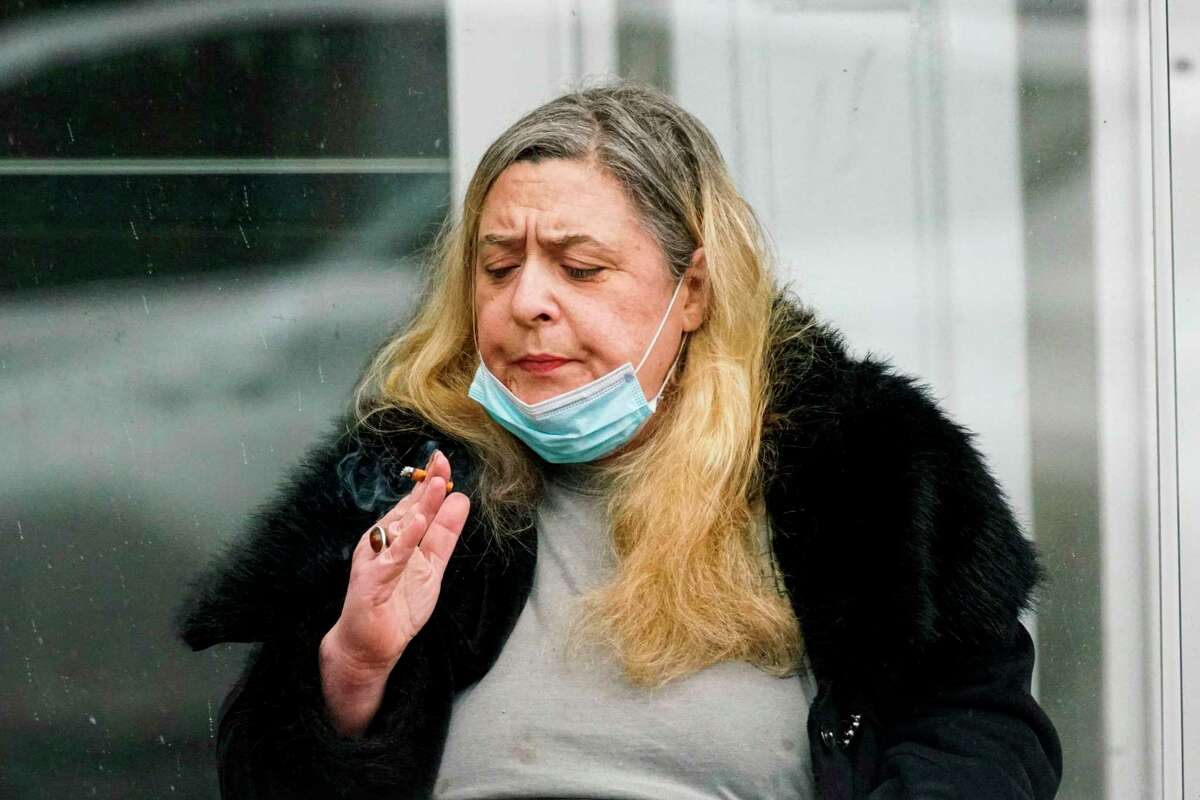 A woman in New York City holsters her mask to smoke a cigarette. These two things don't go together. Smoking raises risk factors for everyone - not just smokers - in the age of COVID-19.