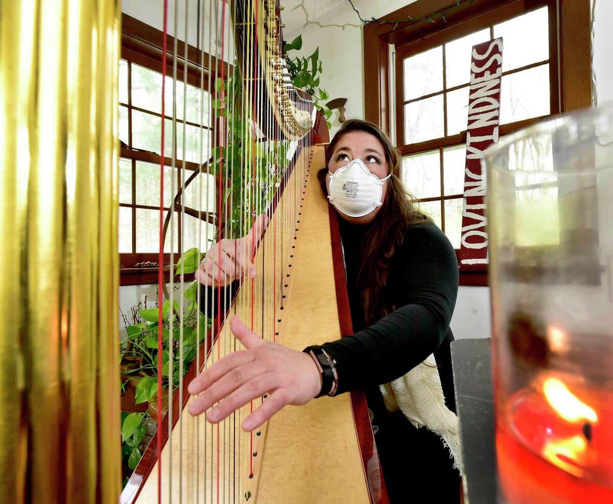 Grace Cloutier, a professional harpist, has started livestreaming harp concerts through her Facebook page every Monday at 5 p.m. as a way to help people manage stress and bring them peace during the coronoavirus pandemic.