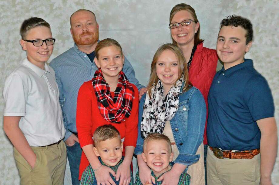 Joni Palmer, back right, with her husband Kyle, back left, and their children, Chase, left, Harley, second from left, Isabelle, second from right, Kaden, right, Hudson, bottom left, and Henry, bottom right. (Photo provided)