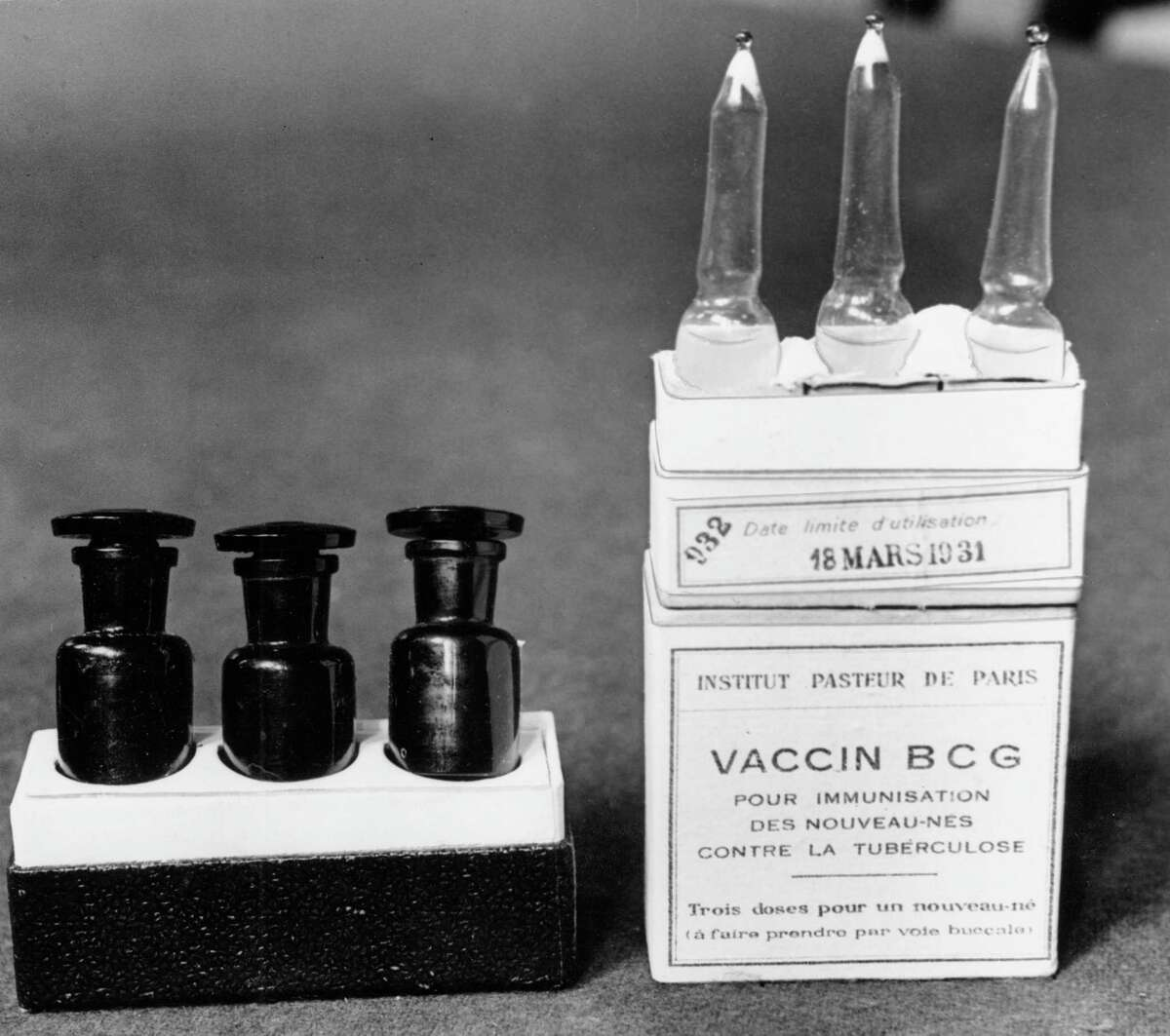 Scientists are dusting off some decades-old vaccines against TB and polio to see if they could provide stopgap protection against COVID-19 until a more precise shot arrives.This March 1931 file photo shows ampules of the BCG vaccine against tuberculosis in a laboratory at the Institute Pasteur in Paris, France.